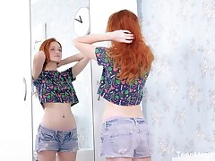 Ardent redhead Foxy Lee has a toy to insert into her wet pink pussy