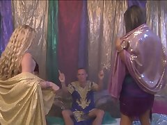 Casual man enjoying an Arabian night with two sex crazed belly dancers