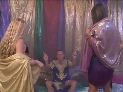 Casual man enjoying an Arabian night with two sex crazed belly dancers