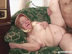 Granny with glasses moans with pleasure and gets cum in mouth