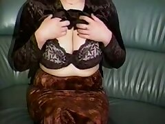 Horn-mad a bit plump amateur cam MILF plays upon her huge knockers