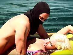Hardcore fucking on the raft betwixt a unperceived alms-man and a sexy blonde