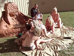 Simmering babes licking and fucking toys in outdoor lesbian orgy
