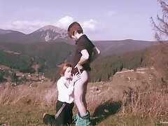Spectacular standing sex in a mountainous setting for sultry redhead