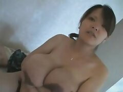 Fluent Japanese milf exposes her large udders
