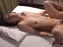 Hardcore missionary fuck with a Japanese brunette in panties