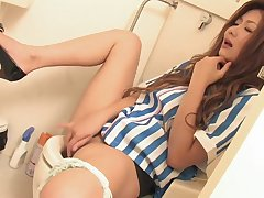 Horny babe in arms pulls off her pantalettes on rub-down the toilet to masturbate