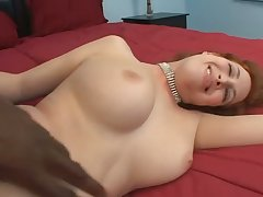 Beautiful buxom redhead Ginger Brightness sucks such a delicious black tool